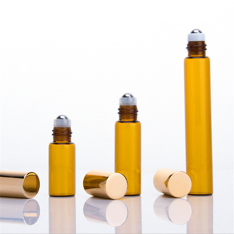 Amber glass roll on bottle with golden cap